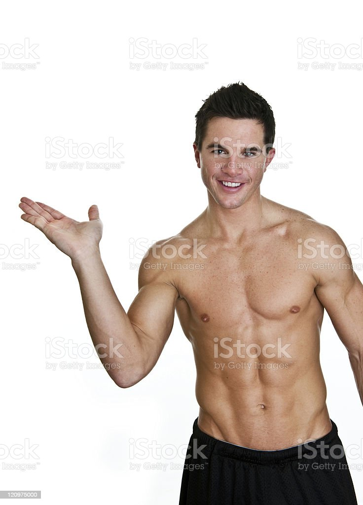 Man in great shape holding hand out for copy space royalty-free stock photo