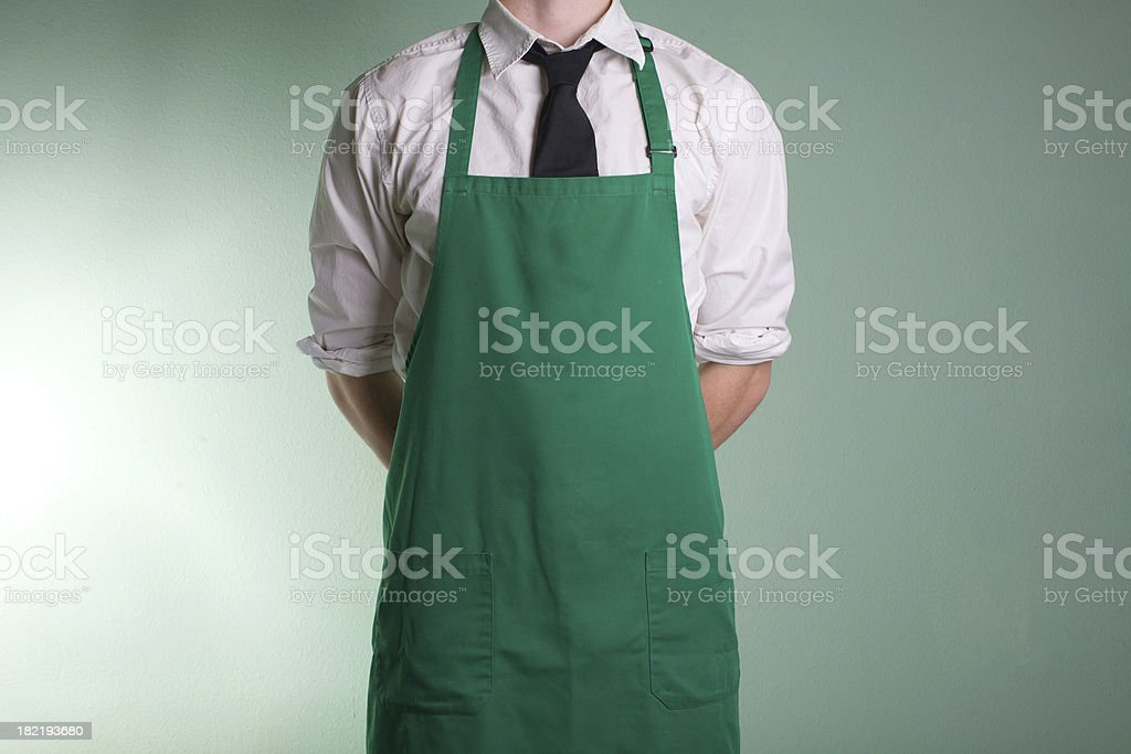 man in green apron royalty-free stock photo