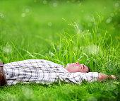 man in green grass