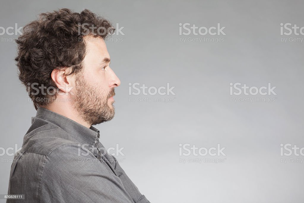 Man in grey shirt, side view stock photo