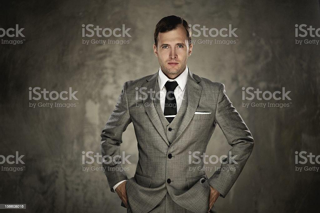 Man in grey suit stock photo