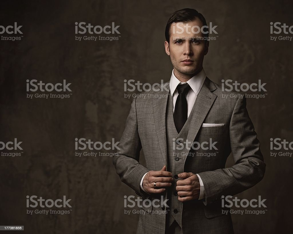 Man in grey suit stock photo