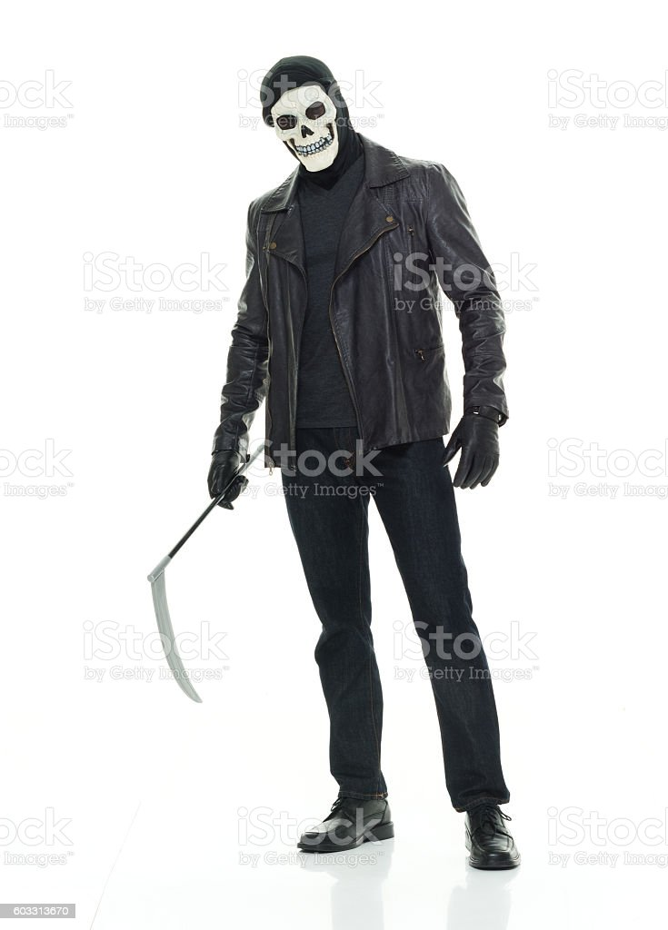 Man in halloween costume and holding scythe stock photo