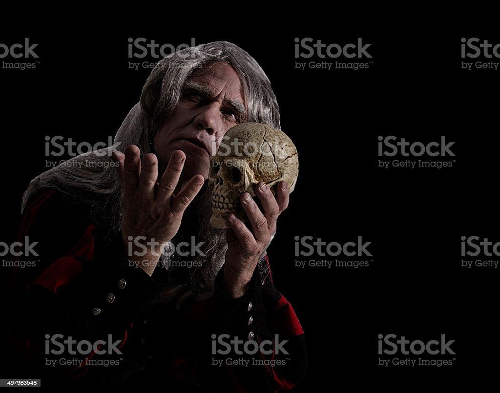 Man in Hamlet costume stock photo