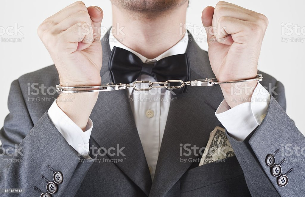 Man in handcuffs for business crime stock photo