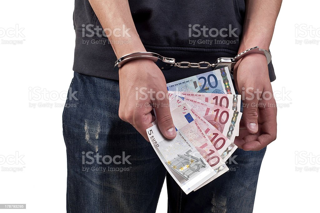 man in handcuffs is holding money over white background royalty-free stock photo