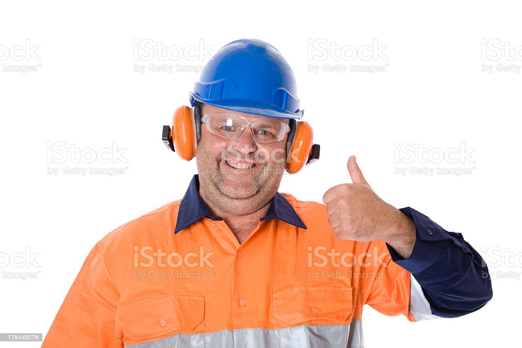 Man in hard hat, safety glasses and goggles giving thumbs up royalty-free stock photo