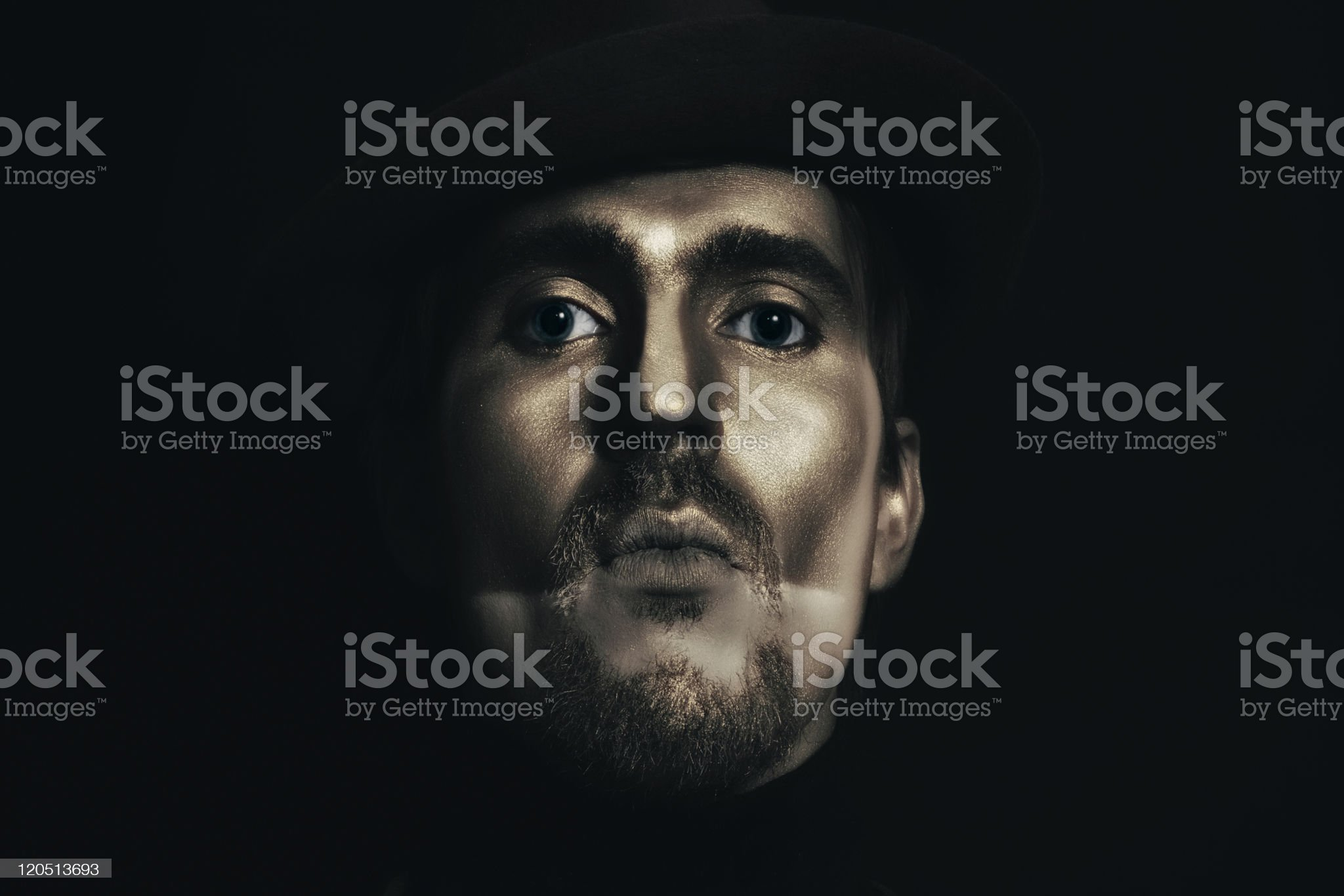 man in hat with bronze makeup royalty-free stock photo