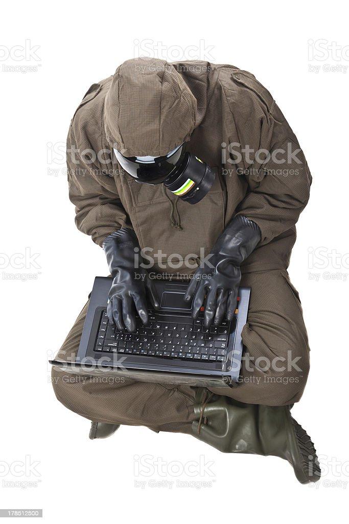Man in Hazard Suit browsing the internet royalty-free stock photo
