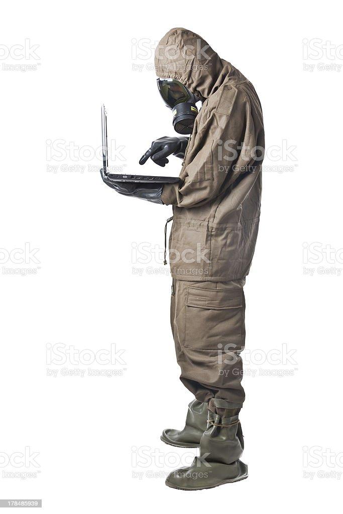 Man in Hazard Suit using a laptop royalty-free stock photo