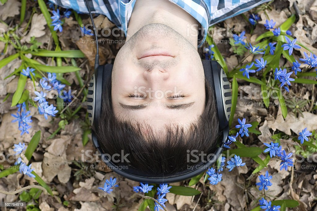 Man in headphones. Flowers royalty-free stock photo