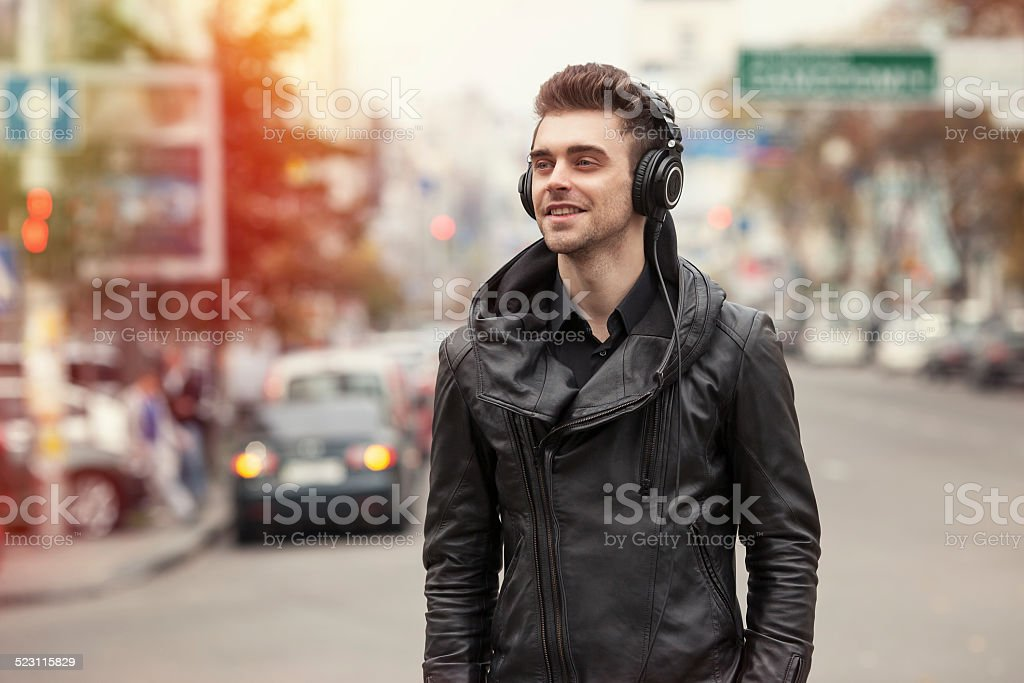 man in headphones on the street stock photo