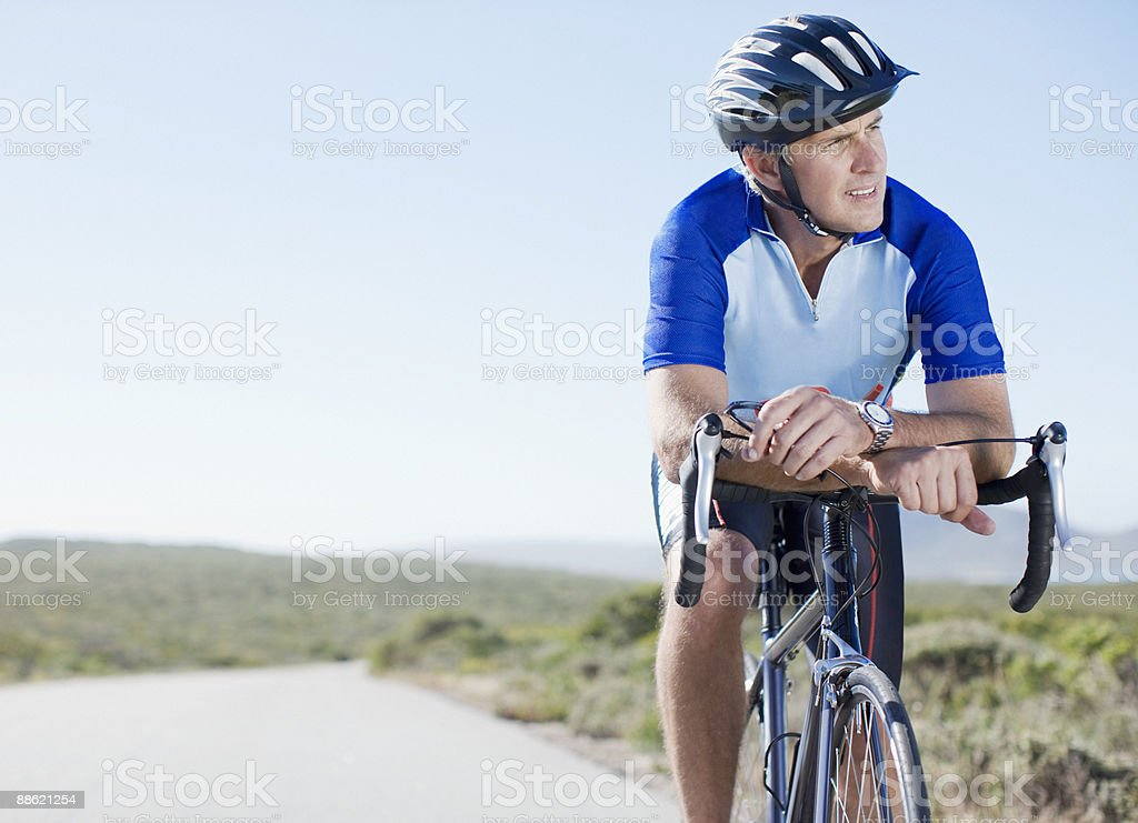 Man in helmet sitting on bicycle stock photo