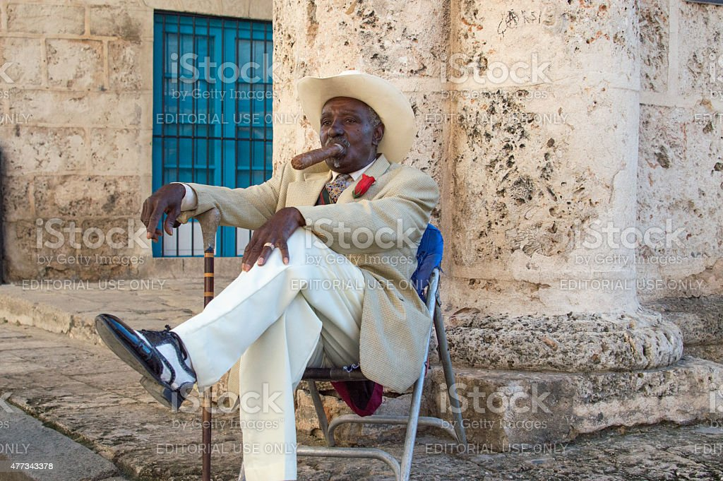 Man in his best suit, smoking a Cuban cigar stock photo