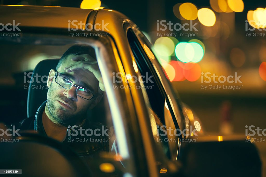 Man in his car stock photo