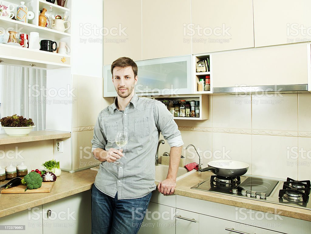 Man in his kitchen royalty-free stock photo