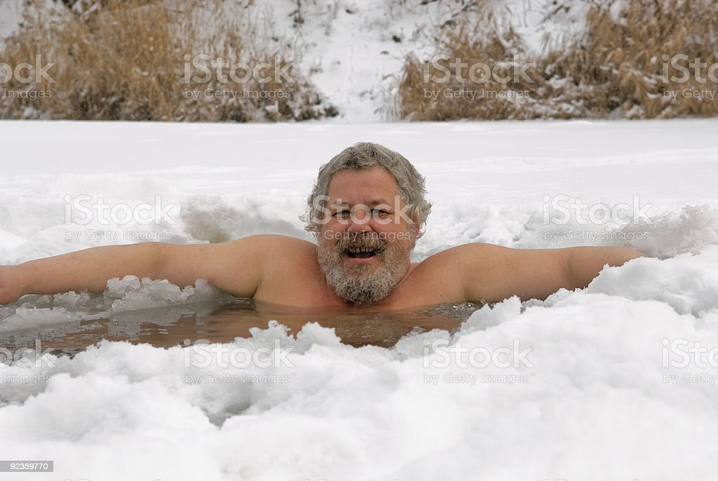 Man in hole cut from ice and snow royalty-free stock photo