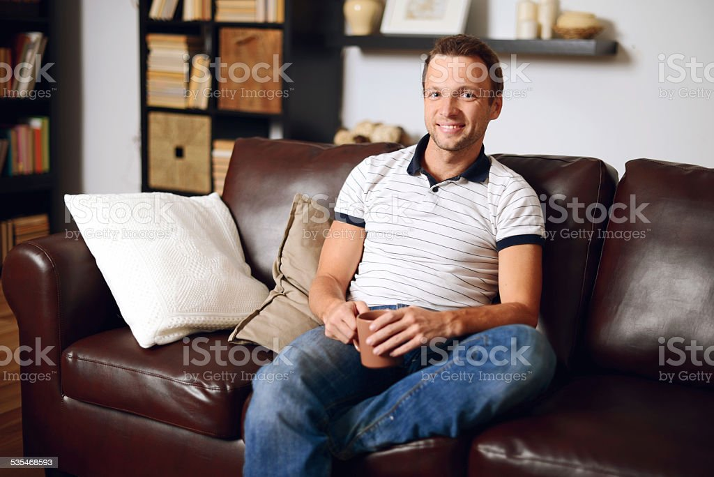 man in home interior stock photo