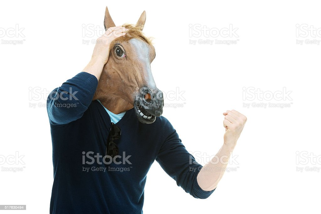 Man in horse costume and cheering stock photo