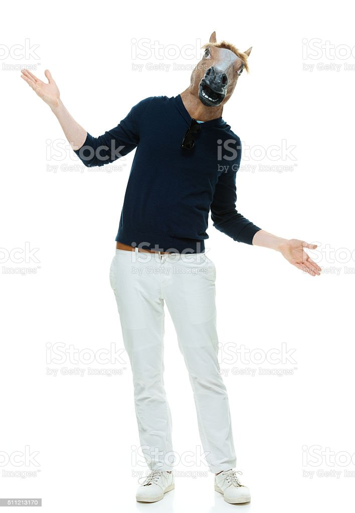 Man in horse costume and presenting stock photo