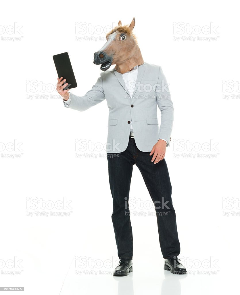 Man in horse costume and taking a selfie stock photo