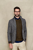 Man in jacket and sweater, studio shot