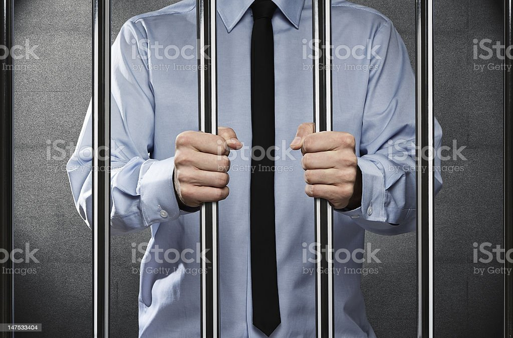 Man in jail stock photo