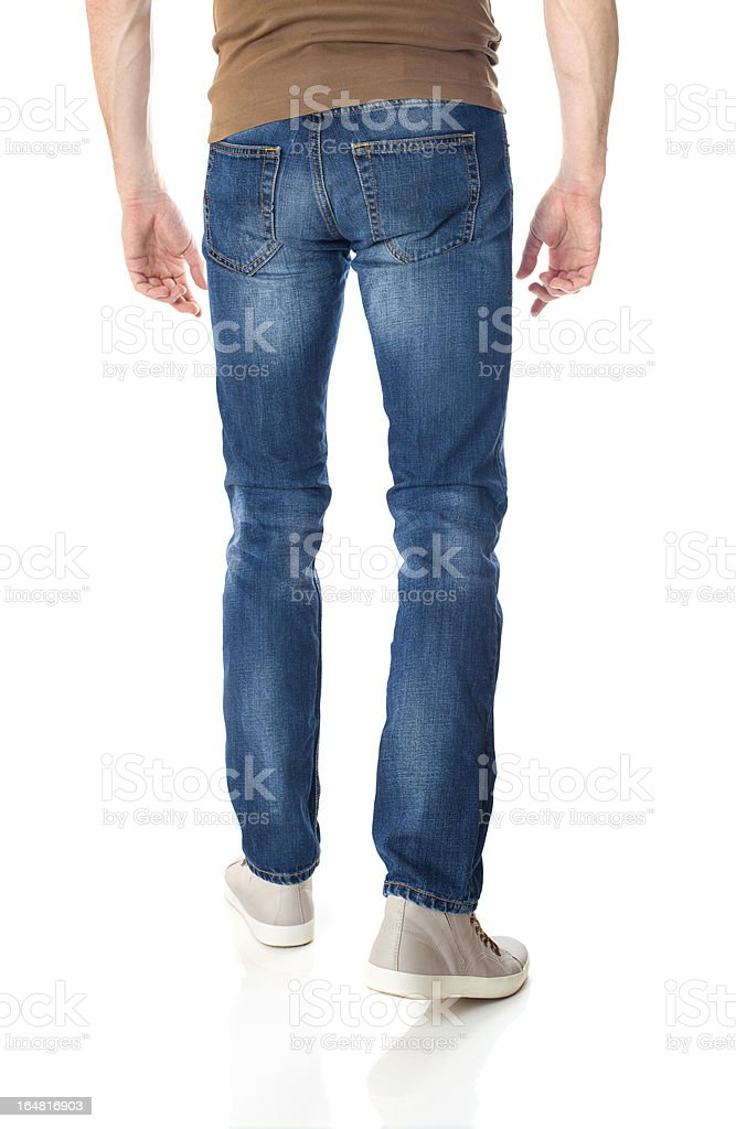 Man in jeans on white stock photo