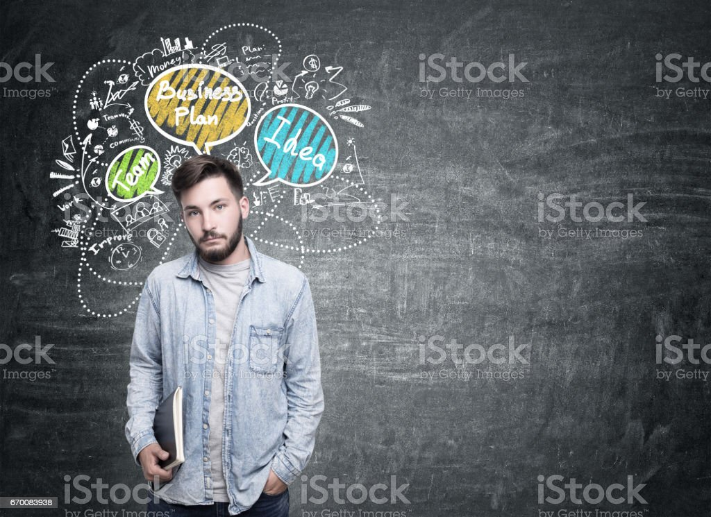 Man in jeans shirt and business plan bubbles stock photo