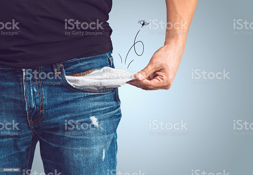 Man in jeans with empty pocket stock photo