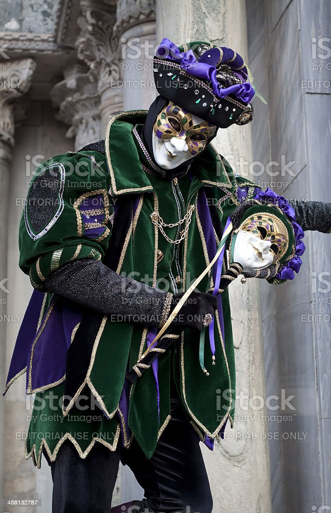 Man in joker costume at Venice Carnival 2011 royalty-free stock photo
