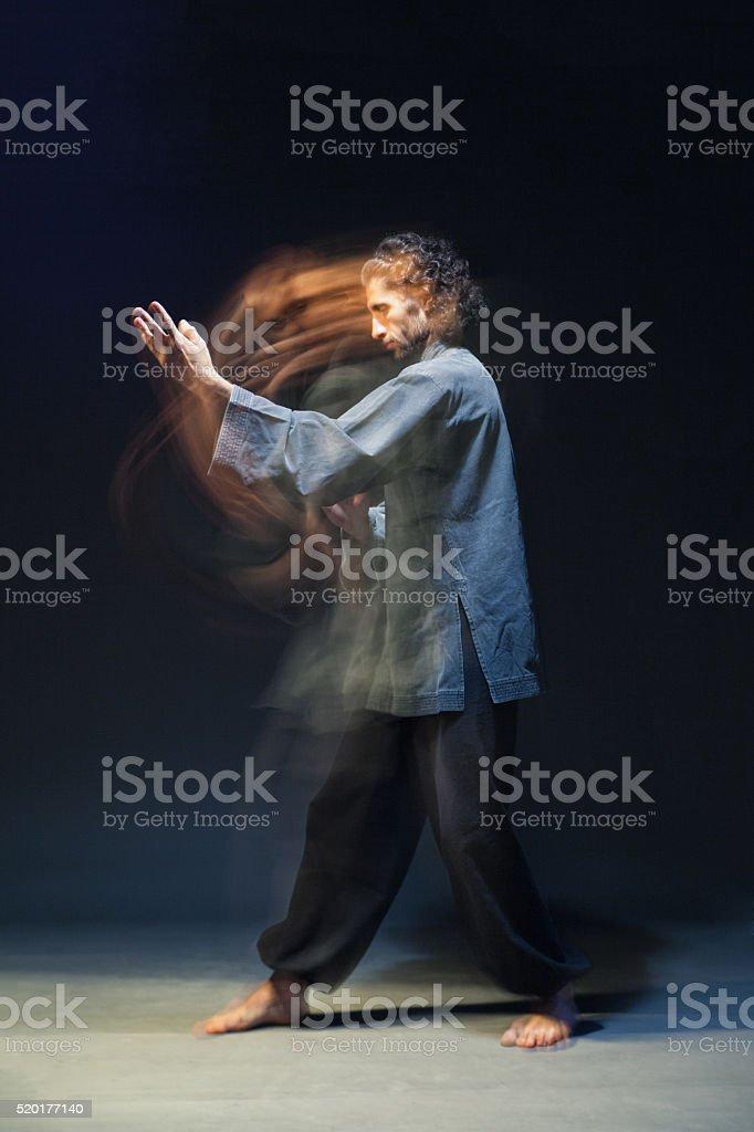 Man in kimono excercising Martial Arts stock photo