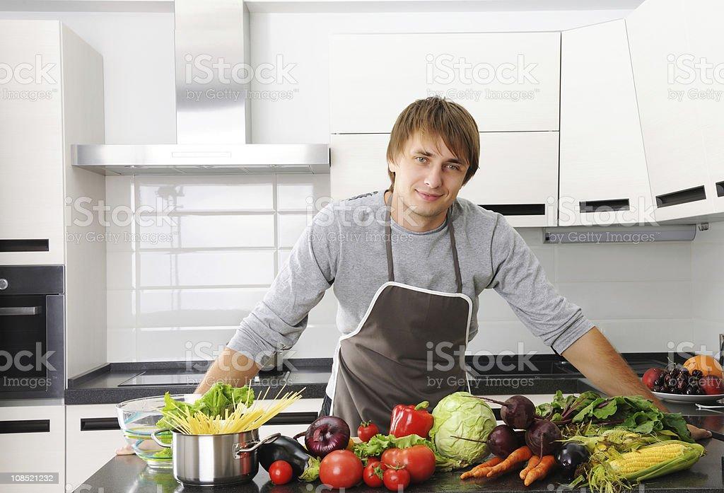 Man in kitchen royalty-free stock photo