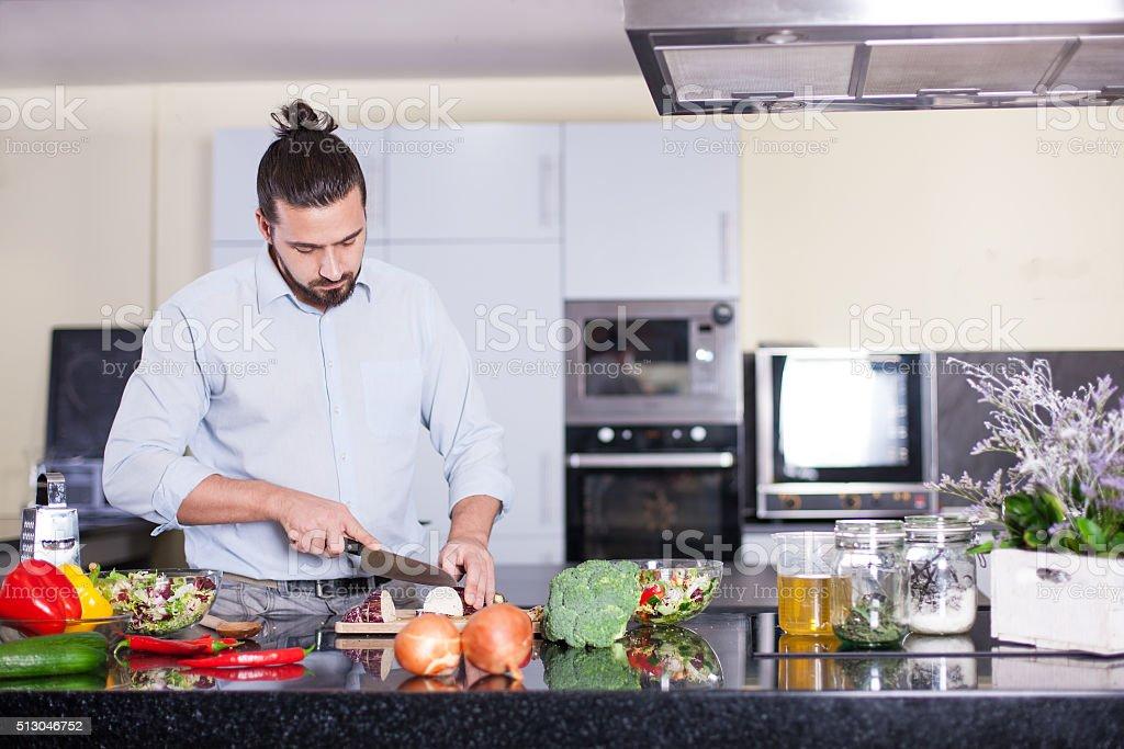 Man in kitchen stock photo