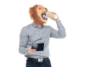 Man in lion costume and drinking coffee