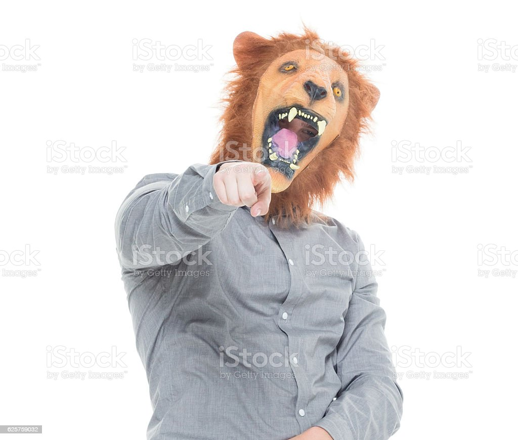 Man in lion costume and pointing at camera stock photo