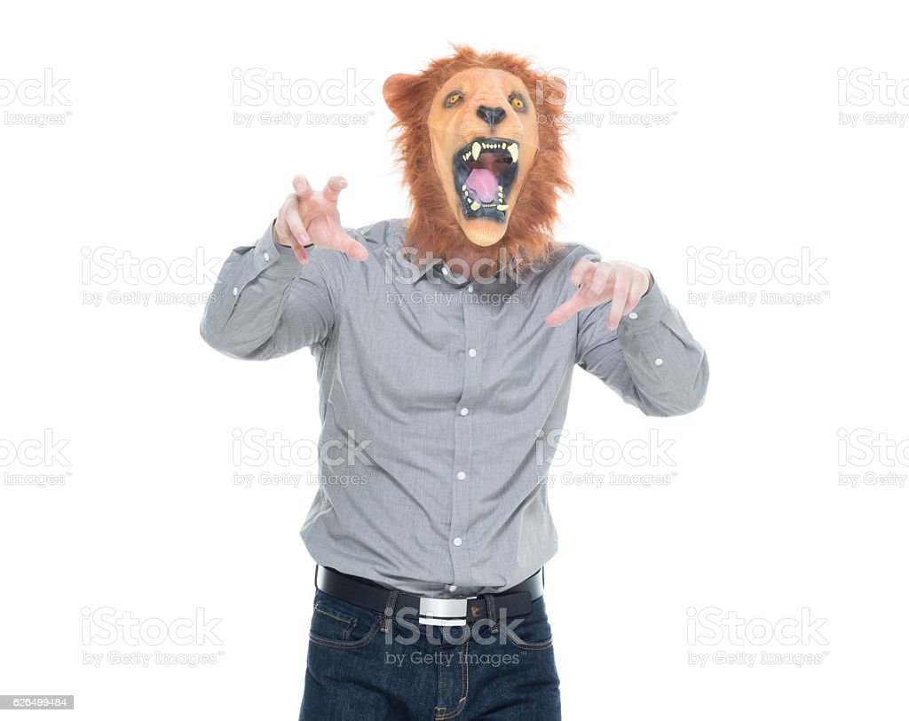 Man in lion costume and shouting stock photo