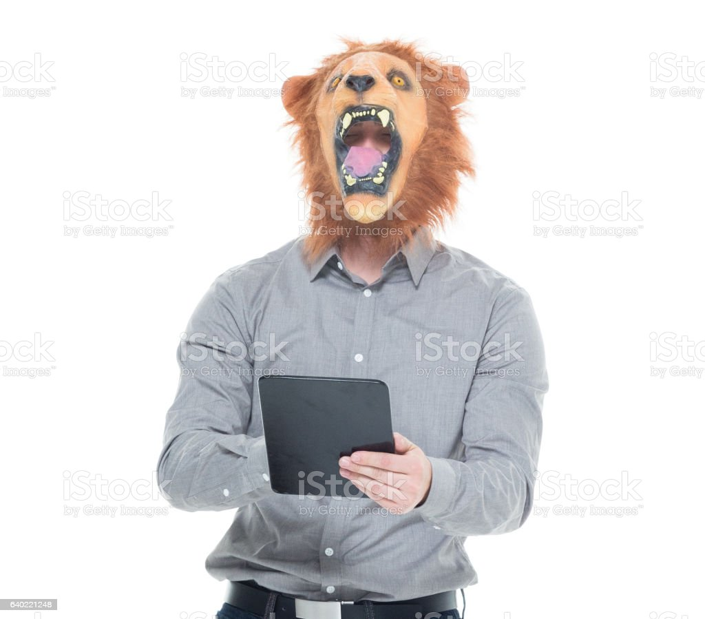 Man in lion costume and using tablet stock photo