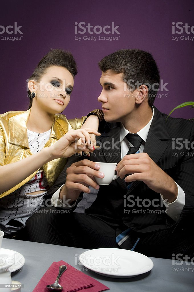 Man in love at restaurant with the girl Punk royalty-free stock photo