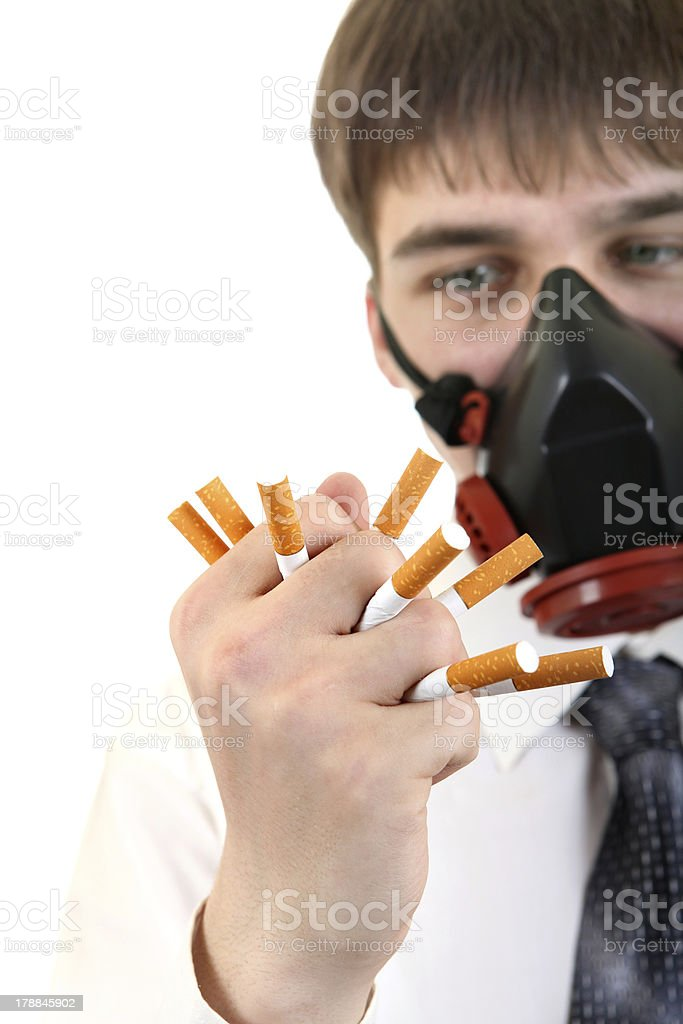 Man in Mask Crushing a Cigarettes royalty-free stock photo