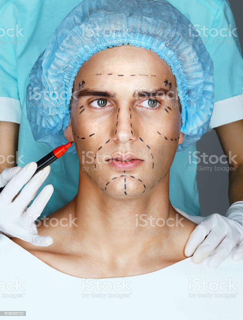 Man in medical hat before plastic surgery stock photo