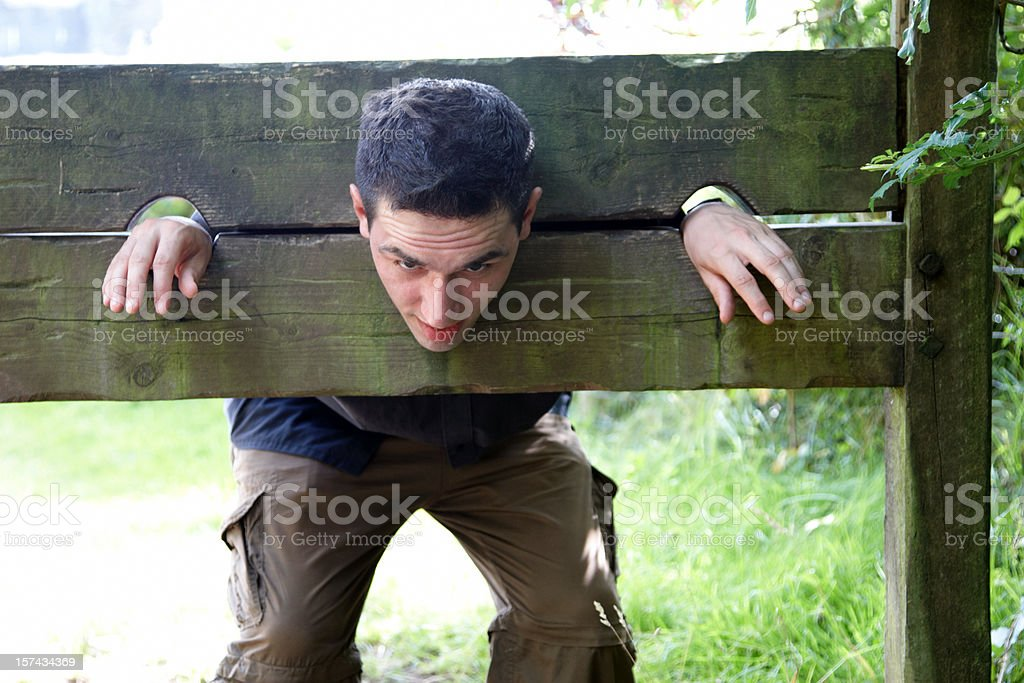Man in medieval stocks royalty-free stock photo