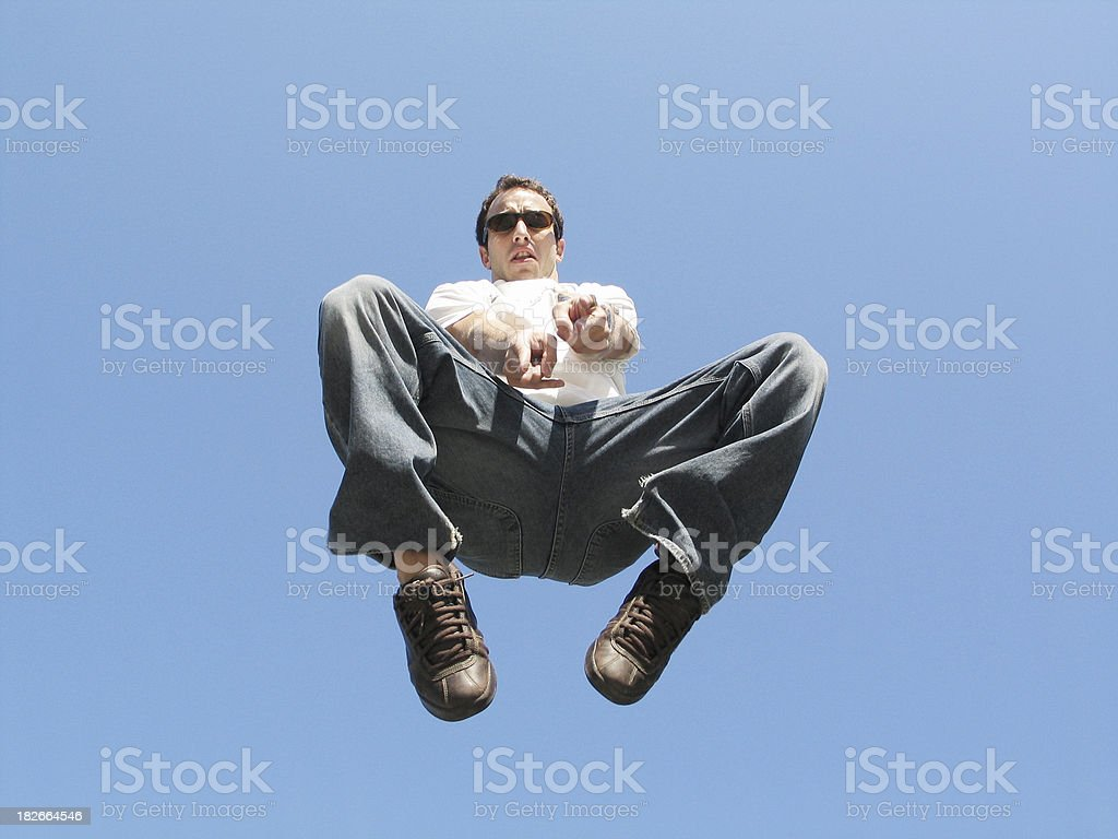Man in mid air pointing at the camera royalty-free stock photo
