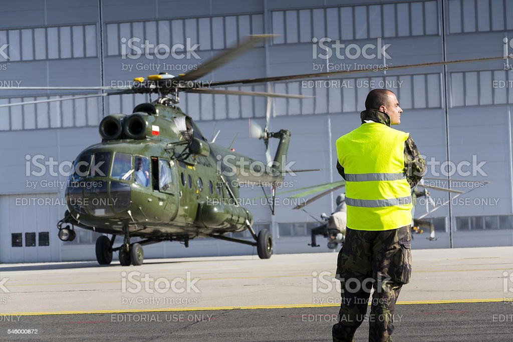 Man in military uniform in front of polish Mi-8T helicopter stock photo