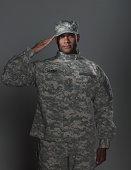 man in military uniform, saluting