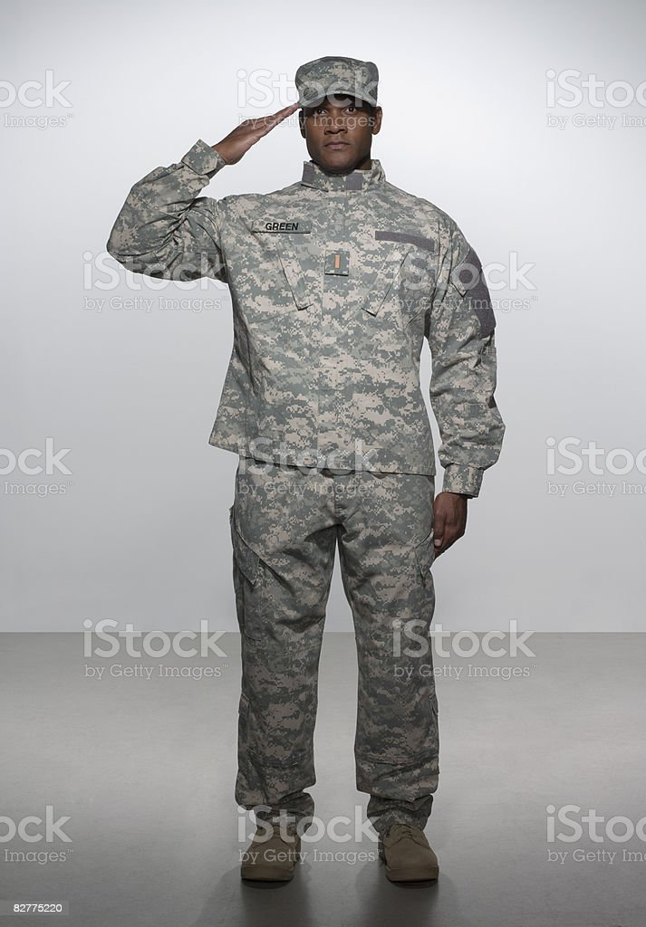 man in military uniform, saluting stock photo