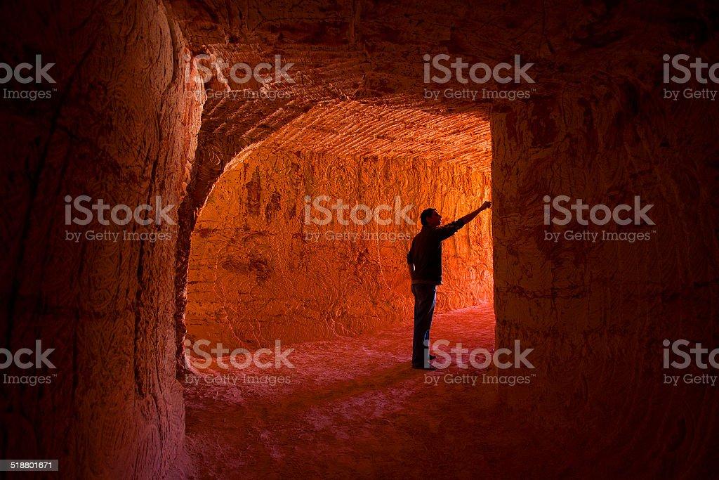 Man in Mine Tunnel, Coober Pedy, South Australia, Australia stock photo
