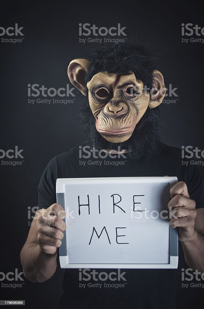 Man In Monkey Mask Looking For Job royalty-free stock photo