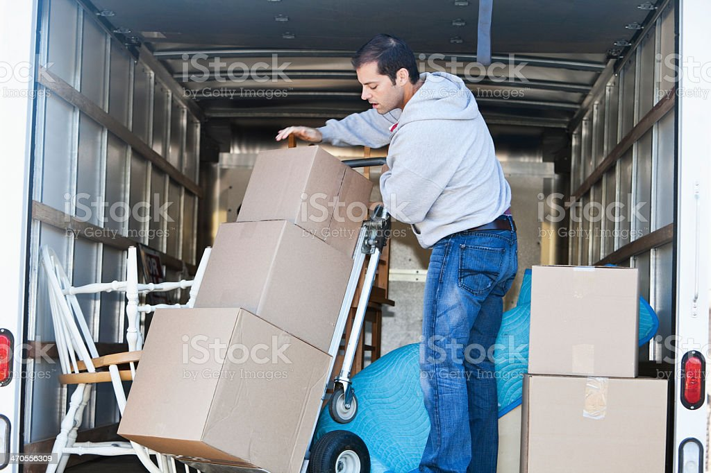 Man in moving truck stock photo