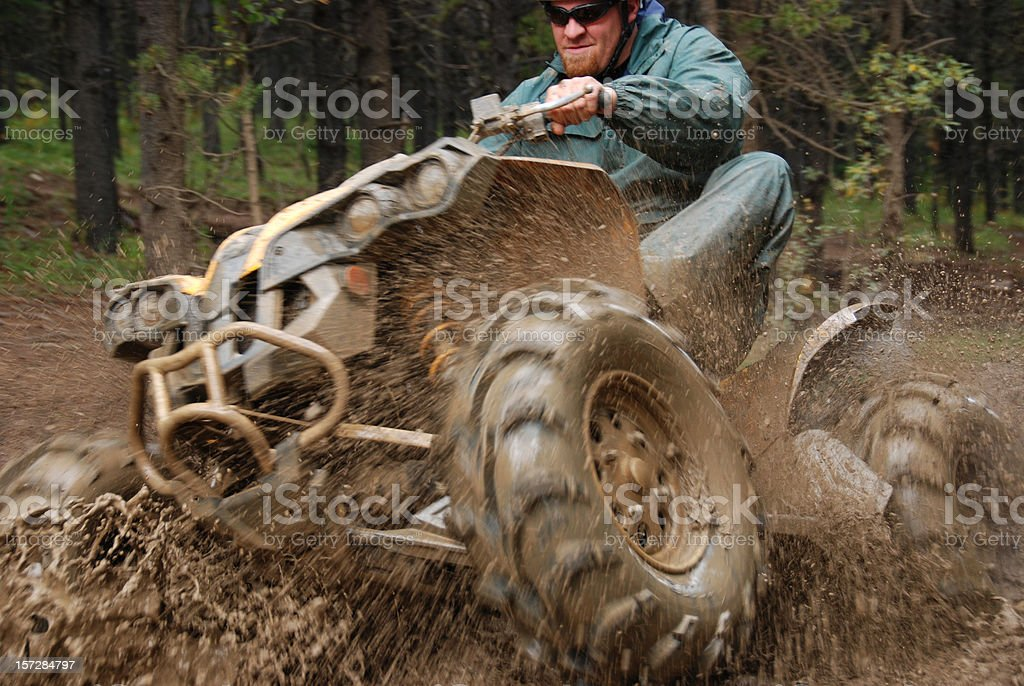 Man in mud on quad stock photo